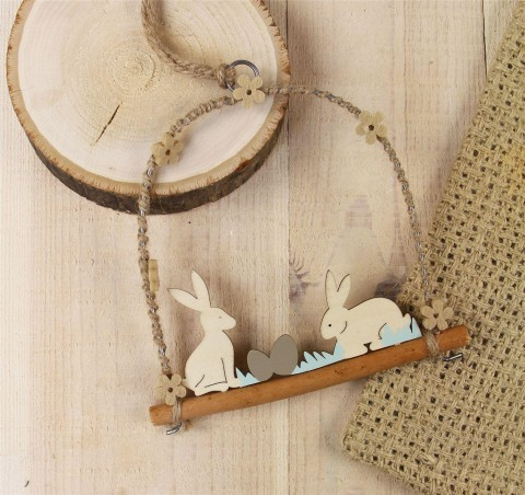 Wood Cut Out Easter Bunnies On Log Decoration