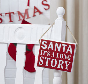 Santa its a long story sign